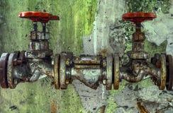 Viejas piezas industriales del abastecimiento de agua Fotos de archivo libres de regalías