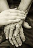 Viejas y jovenes manos Imágenes de archivo libres de regalías