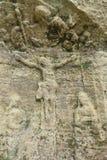Viejo alivio de Jesus Christ en una roca de la piedra arenisca Fotografía de archivo