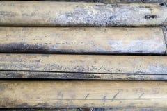 Viejo amarillo anticuado de bambú de madera del fondo imagenes de archivo