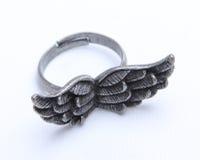 Viejo anillo con las alas Foto de archivo libre de regalías