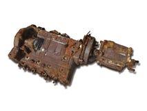Viejo bloque de motor oxidado en blanco Fotos de archivo libres de regalías