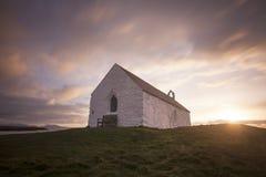 Viejo chuch en la puesta del sol Fotografía de archivo libre de regalías