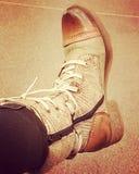 Viejo de botas del arnés dentro imagen de archivo libre de regalías