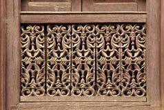 Viejo detalle nepalés tradicional de madera de la ventana nepal Fotografía de archivo libre de regalías