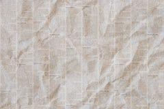 Viejo fondo arrugado de la textura del periódico