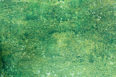 Viejo fondo de la pared de la pintura del verde de la peladura Foto de archivo