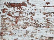 Viejo fondo de la pared de ladrillo con la pintura blanca foto de archivo