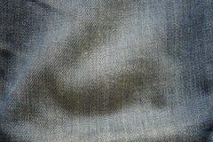 Viejo fondo de la textura de la tela de los pantalones de la mezclilla del primer imagenes de archivo