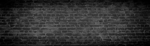 Viejo fondo negro de la pared de ladrillo Fotografía de archivo libre de regalías