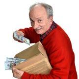 Viejo hombre afortunado que sostiene la caja con los billetes de dólar Imagen de archivo libre de regalías