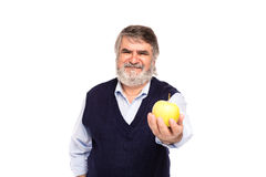 Viejo hombre con la manzana en manos Fotografía de archivo