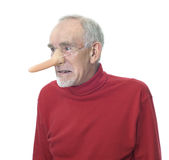 Viejo hombre gruñón que desgasta la nariz falsa larga Fotos de archivo libres de regalías