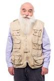 Viejo hombre que lleva la chaqueta sin mangas foto de archivo libre de regalías