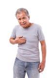 Viejo hombre que sufre del ardor de estómago, reflujo ácido fotografía de archivo libre de regalías