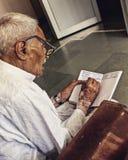Viejo hombre y su lechería Foto de archivo