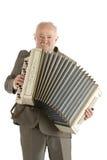 Viejo jugador de la armónica Fotos de archivo libres de regalías