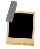 Viejo marco de la foto sujetado con cinta adhesiva Foto de archivo