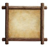 Viejo marco de madera con el fondo del papel o del pergamino aislado Fotografía de archivo libre de regalías