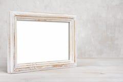 Viejo marco pintado de la foto en la tabla sobre fondo abstracto Foto de archivo libre de regalías