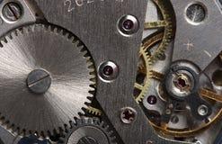 Viejo mecanismo de engranaje del reloj imagenes de archivo
