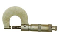 Viejo micrómetro aislado en un fondo blanco fotos de archivo libres de regalías