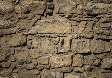 Viejo modelo marrón de la pared de piedras Foto de archivo