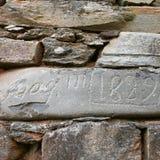 Viejo nombre en piedra Imágenes de archivo libres de regalías