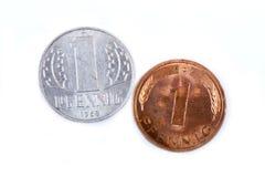 Viejo oeste y monedas germanoorientales, pfennig Imagen de archivo libre de regalías