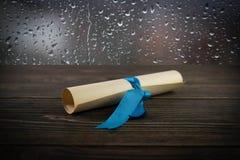 Viejo rollo en el fondo de madera Imágenes de archivo libres de regalías