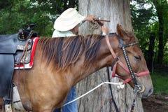 Viejo vaquero con el caballo Foto de archivo libre de regalías