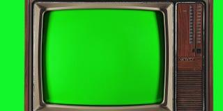 Viejo vintage TV con la pantalla y el fondo verdes