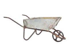 Viejo weelbarrow del metal fotografía de archivo libre de regalías