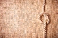 Viejos arpillera y nudo Imágenes de archivo libres de regalías