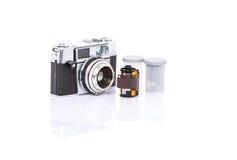 Viejos cámara y carrete de película análogos I Fotos de archivo