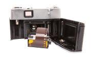 Viejos cámara y carrete de película análogos VI Fotos de archivo