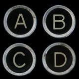 Viejos claves de la máquina de escribir A B C D Imágenes de archivo libres de regalías