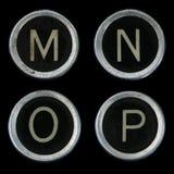 Viejos claves de la máquina de escribir M N O P Fotos de archivo