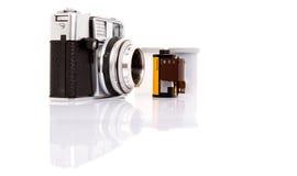 Viejos cámara y carrete de película análogos III Imagen de archivo