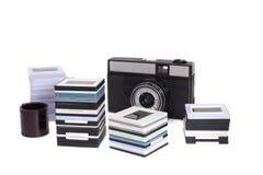 Viejos marcos de la cámara y del plástico de SLR con las diapositivas Foto de archivo libre de regalías