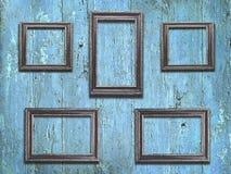 Viejos marcos de madera en fondo de madera azul del vintage Imágenes de archivo libres de regalías