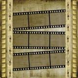 Viejos papeles y filmstrip del grunge Imágenes de archivo libres de regalías