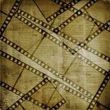 Viejos papeles y filmstrip del grunge Foto de archivo