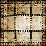 Viejos papeles y filmstrip del grunge Foto de archivo libre de regalías