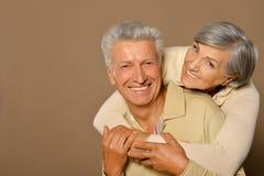 Viejos pares sonrientes Imágenes de archivo libres de regalías