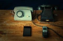 Viejos y nuevos phons Fotos de archivo libres de regalías