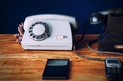 Viejos y nuevos phons Imagen de archivo