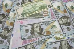 Viel Dollar und Eurobanknote als Hintergrund stockbild
