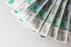 Viel Geldfan auf einem weißen Hintergrund stockbilder