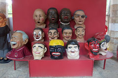 Viel Volks-Art Masks Stockfotos